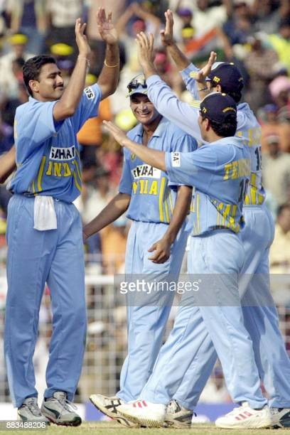 Compatriots congratulate Indian captain Anil Kumble after he took the wicket of Michael Vaughan of England during their third oneday match at the MA...