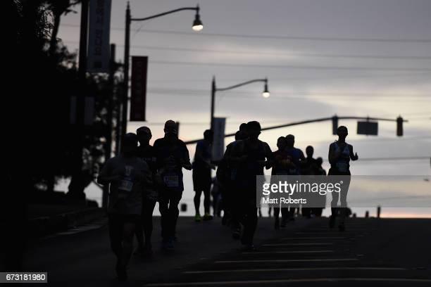 Compeitors run at dawn during the United Airlines Guam Marathon 2017 on April 9 2017 in Guam Guam