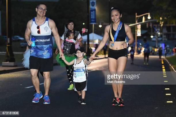 Compeitors run before dawn during the United Airlines Guam Marathon 2017 on April 9 2017 in Guam Guam