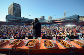 Competetive eater Eric Badlands Booker raps for the crowd at the national chicken wing eating contest on September 6 2015 in Buffalo New YorkThe...