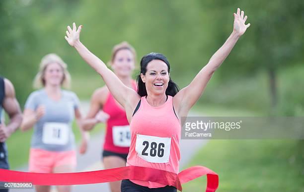 Competetive runner winning a race