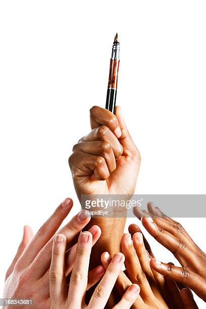 Competing to communicate, many mixed hands grab for pen