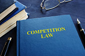 Competition law and pen on a table.