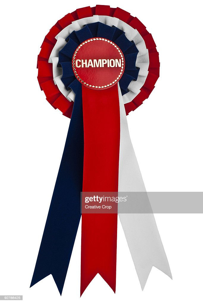 Competition rossette red white and blue CHAMPION : Bildbanksbilder