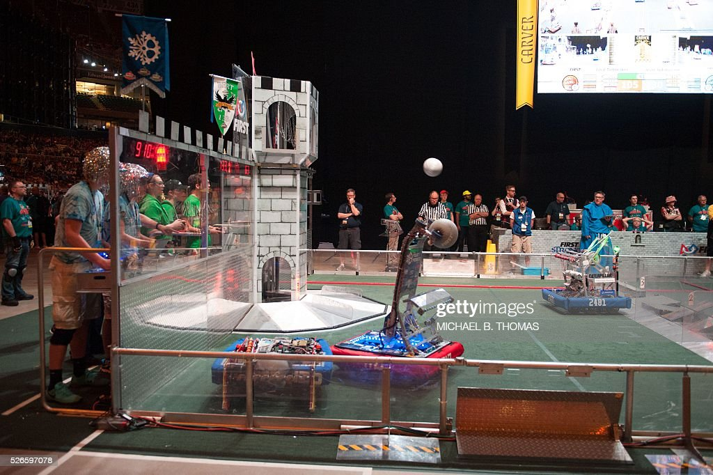 Competition takes place during the FIRST Robotics Championships on April 30, 2016 in St. Louis, Missouri. Six hundred teams representing 10 countries compete over three days. / AFP / Michael B. Thomas