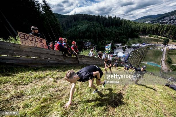 Competitiors make their way up the 400 metre skijump at Hochfirstschanze during the Red Bull 400 World Championship at TitiseeNeustadt Germany on...