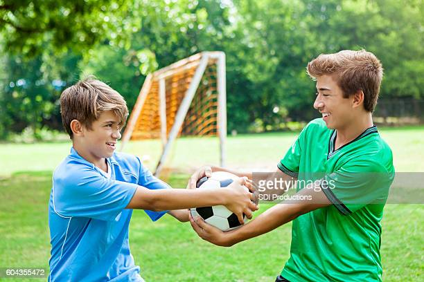 Competitive brothers fight over soccer ball