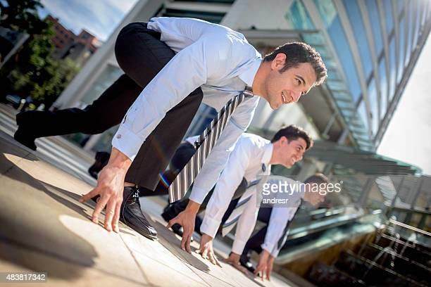 Competitive business men racing