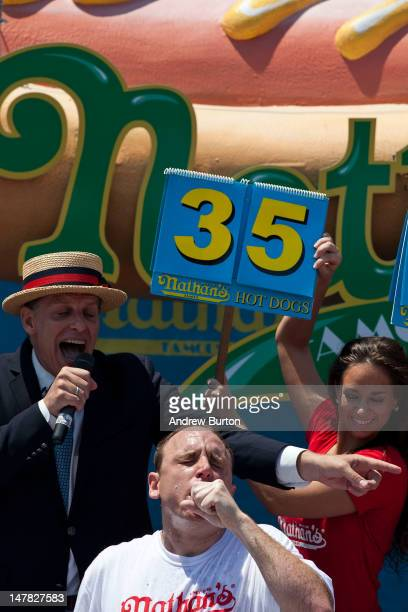 Competitive eater Joey Chestnut competes in the Nathan's Famous International Hot Dog Eating Contest at Coney Island on July 4 2012 in the Brooklyn...