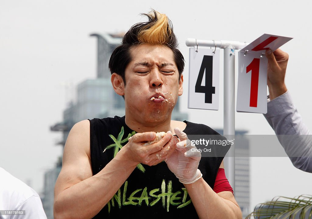 Competitive eater <a gi-track='captionPersonalityLinkClicked' href=/galleries/search?phrase=Takeru+Kobayashi&family=editorial&specificpeople=2280293 ng-click='$event.stopPropagation()'>Takeru Kobayashi</a> challeges 2011 Nathan's Famous Hot Dog Eating Competition Contestants via satellite at 230 Fifth Avenue on July 4, 2011 in New York City.