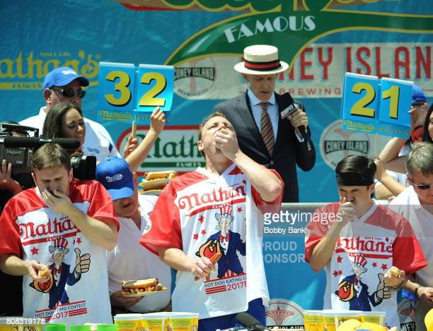 Competitive eaters Carmen Cincotti Joey Chestnut and Matt Stonie at the 2017 Nathans Famous 4th Of July International Hot Dog Eating Contest with 72...