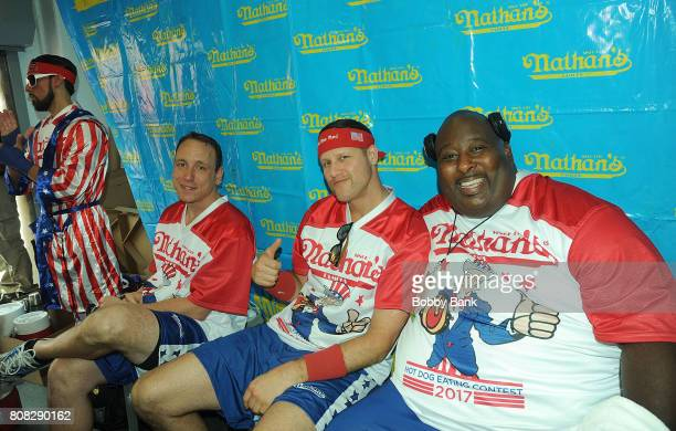Competitive eaters Joey Chestnut Erik Denmark and Eric Booker at the 2017 Nathans Famous 4th Of July International Hot Dog Eating Contest at Coney...