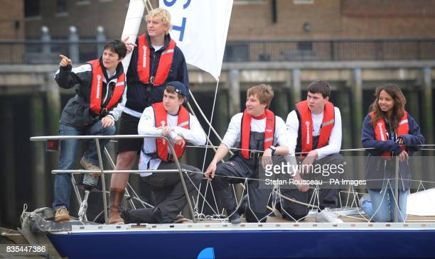 Competitive sailor Ellen MacArthur sails past Tower Bridge in London aboard 'Scarlet Oyster' with a group of children who are all recovering from...