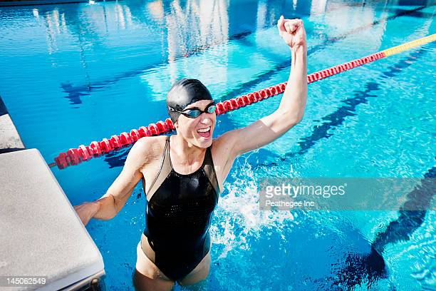 Competitive swimmer cheering in swimming pool