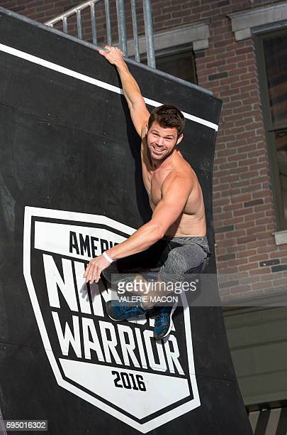 Competitor Ben Malick poses on the final wall of the challenge during the 'American Ninja Warrior' screening and course demonstration In celebration...