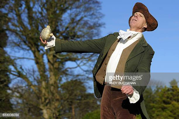 Competitor Bill Boyd in Robert Burns era costume throws a haggis during the 2017 World Haggis Hurling Championships at Burns Cottage in Alloway...