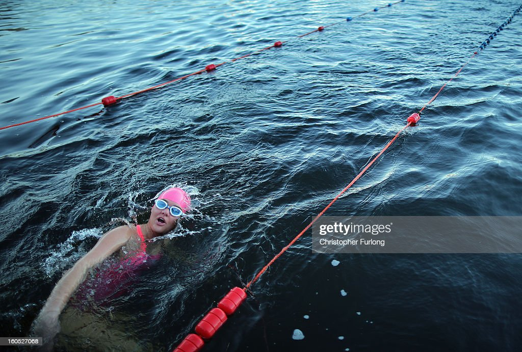 A competitor braves the chilly temperatures during The Big Chill open swimming event in Lake Windermere on February 2, 2013 in Windermere, England. The Big Chill swimmers plunged into Lake Windermere, where the water temperature was an average of four degrees celsius, for a series of events including relays, endurance and fun swims.