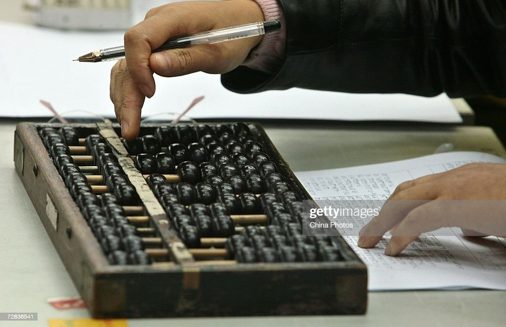 A competitor calculates with an abacus during a folk contest of abacus calculations December 16 2006 in Nanjing of Jiangsu Province China Abacus was...