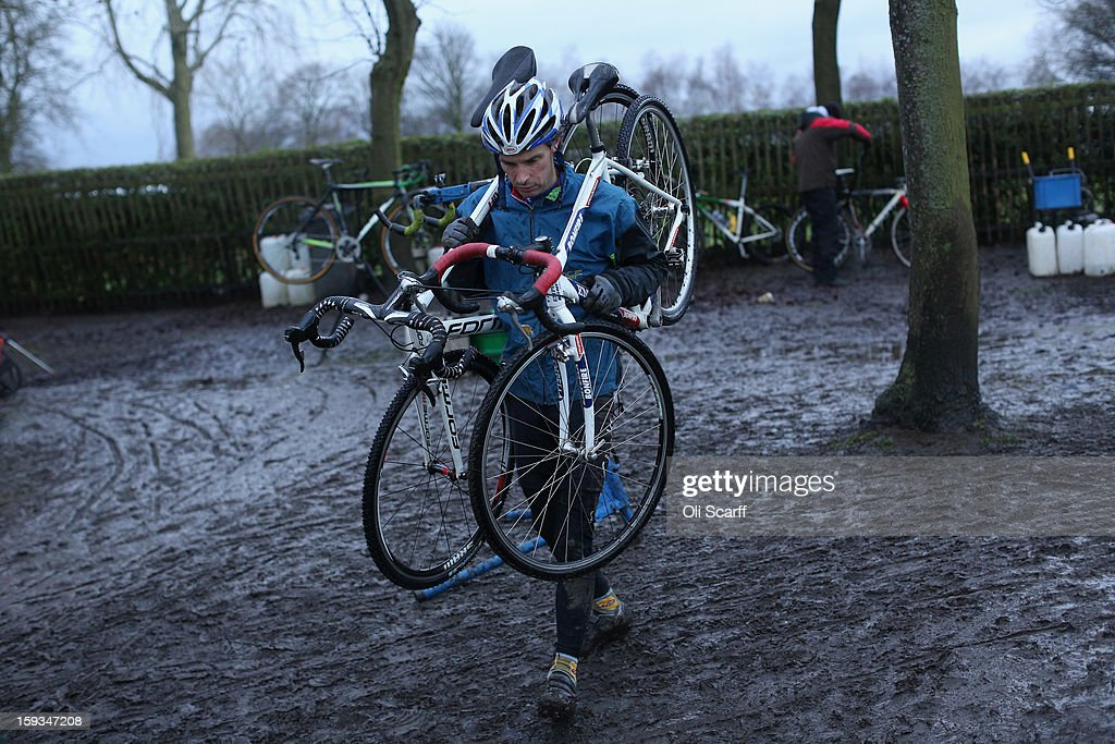 A competitor carries his bikes following the 'Veteran 40-49 Men' category race at the 2013 National Cyclo-Cross Championships in Peel Park on January 12, 2013 in Bradford, England. The sport of cyclo-cross, featuring lightweight bikes with off-road tyres, has dramatically increased in popularity over the past few years. Cyclo-cross courses are often run over a mixture of terrains from tarmac to mud and frequently include obstacles or steep inclines where riders have to carry their bike.