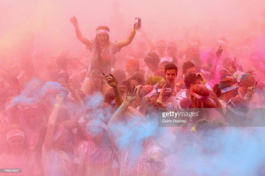Competitor celebrate completing the Colour Run on November 25, 2012 in Melbourne, Australia.