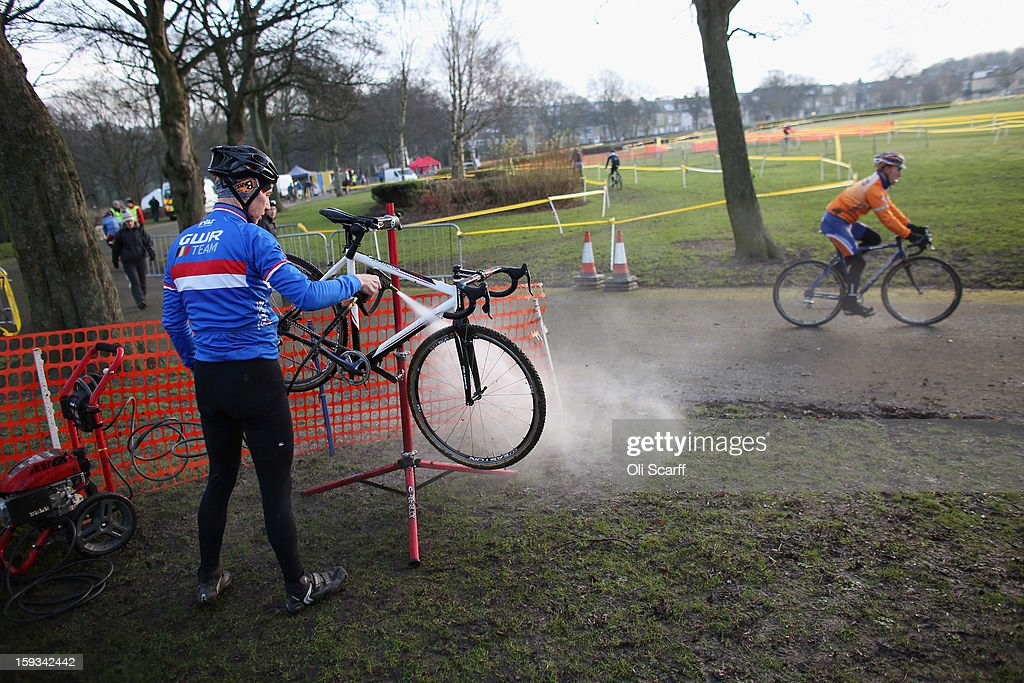 A competitor cleans his bike before the 'Veteran Men 50+' category race at the 2013 National Cyclo-Cross Championships in Peel Park on January 12, 2013 in Bradford, England. The sport of cyclo-cross, featuring lightweight bikes with off-road tyres, has dramatically increased in popularity over the past few years. Cyclo-cross courses are often run over a mixture of terrains from tarmac to mud and frequently include obstacles or steep inclines where riders have to carry their bike.
