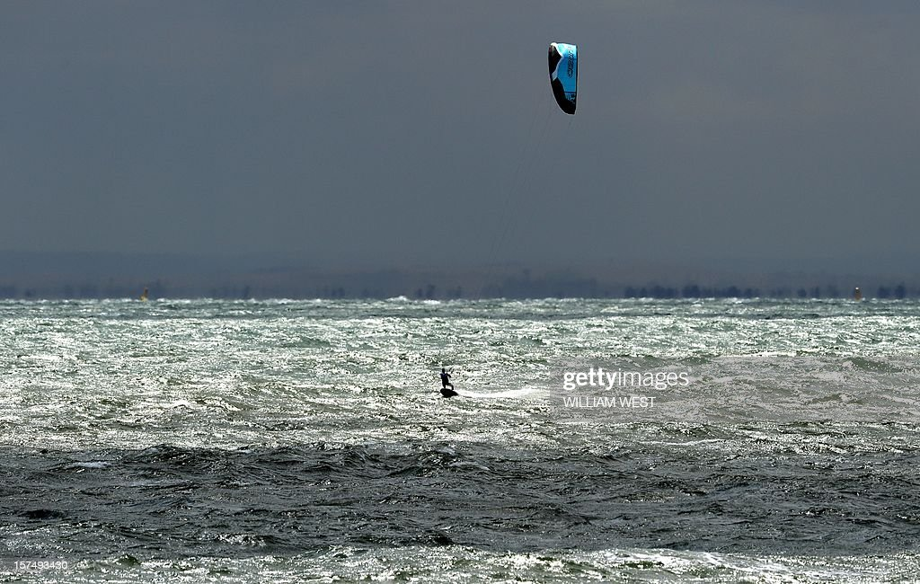 A competitor competes in the strong winds during the kiteboarding class at the ISAF Sailing World Cup event in Melbourne on December 4, 2012. Strong winds posponed racing in all other classes on Melbourne's Port Phillip Bay. AFP PHOTO/William WEST IMAGE RESTRICTED TO EDITORIAL USE - STRICTLY NO COMMERCIAL USE