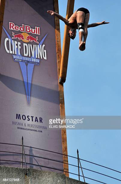 A competitor dives from the Stari Most bridge in Mostar during the Cliff Diving World Series competition on August 15 2015 Competitors jump from a...