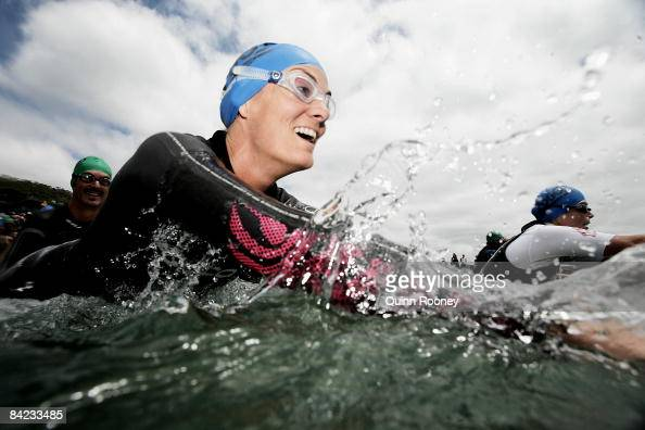 A competitor dives into the water ready to start the swim during the Lorne Pier To Pub open water swim at Louttit Bay January 10 2009 in Lorne...