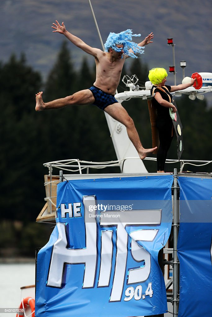 A competitor dives off the wharf during the American Express Queenstown Winter Festival Hits 90.4 Birdman competition on June 26, 2016 in Queenstown, New Zealand.