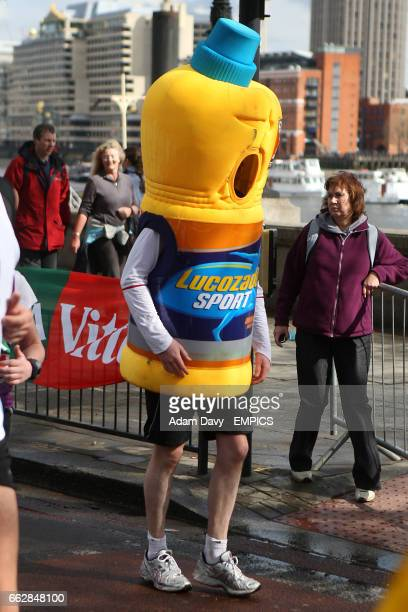 A competitor dressed as a bottle of Lucozade Sport during the Flora London Marathon 2008