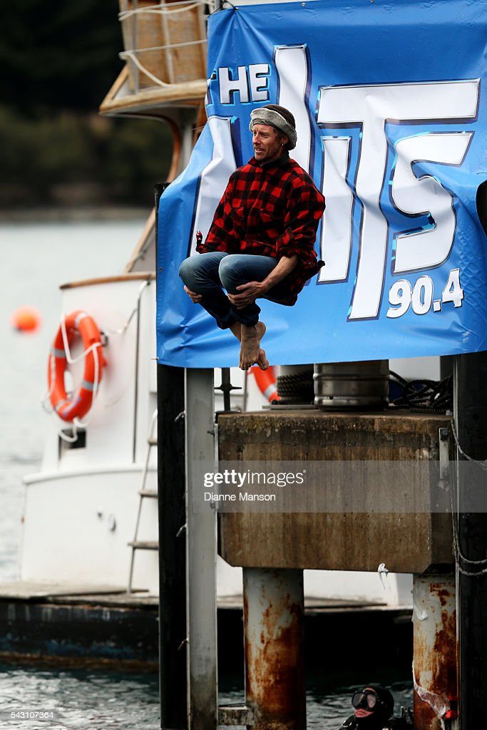 A competitor dressed as a farmer dives off the wharf during the American Express Queenstown Winter Festival Hits 90.4 Birdman competition on June 26, 2016 in Queenstown, New Zealand.