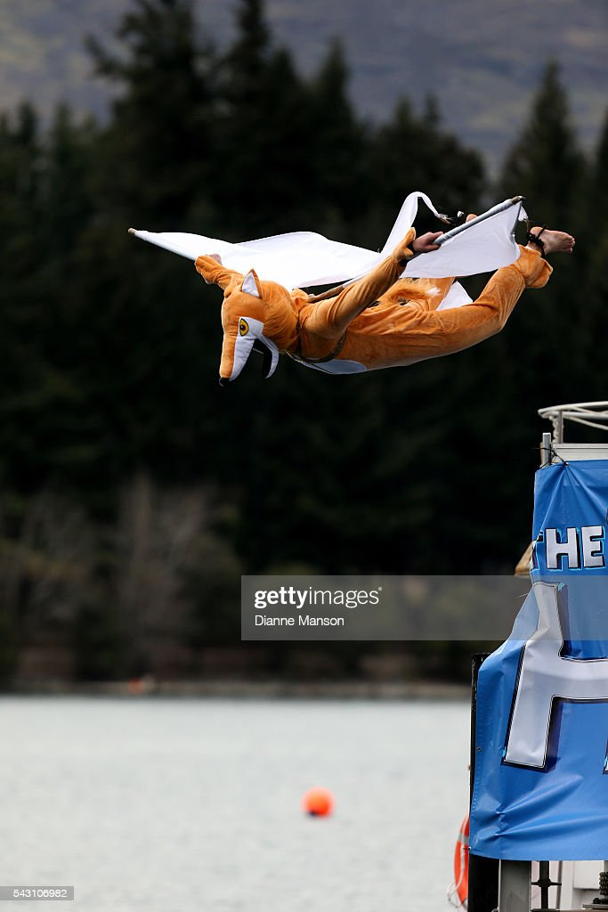 A competitor dressed as a flying fox dives off the wharf during the American Express Queenstown Winter Festival Hits 90.4 Birdman competition on June 26, 2016 in Queenstown, New Zealand.