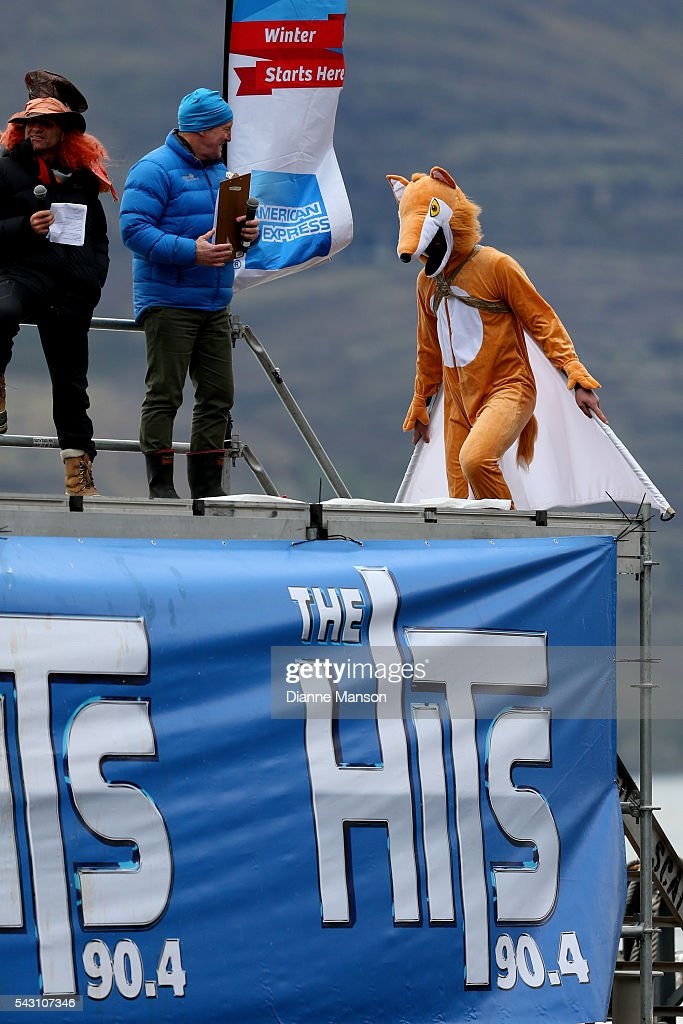 A competitor dressed as a flying fox gets ready to dive off the wharf during the American Express Queenstown Winter Festival Hits 90.4 Birdman competition on June 26, 2016 in Queenstown, New Zealand.