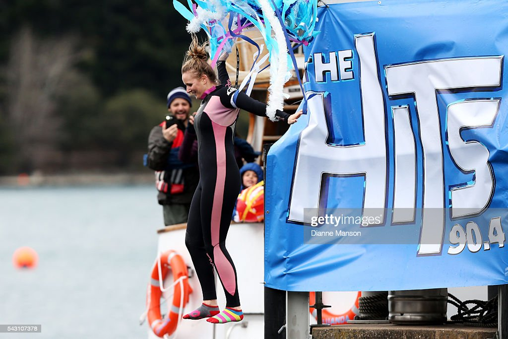 A competitor dressed as a jelly fish dives off the wharf during the American Express Queenstown Winter Festival Hits 90.4 Birdman competition on June 26, 2016 in Queenstown, New Zealand.
