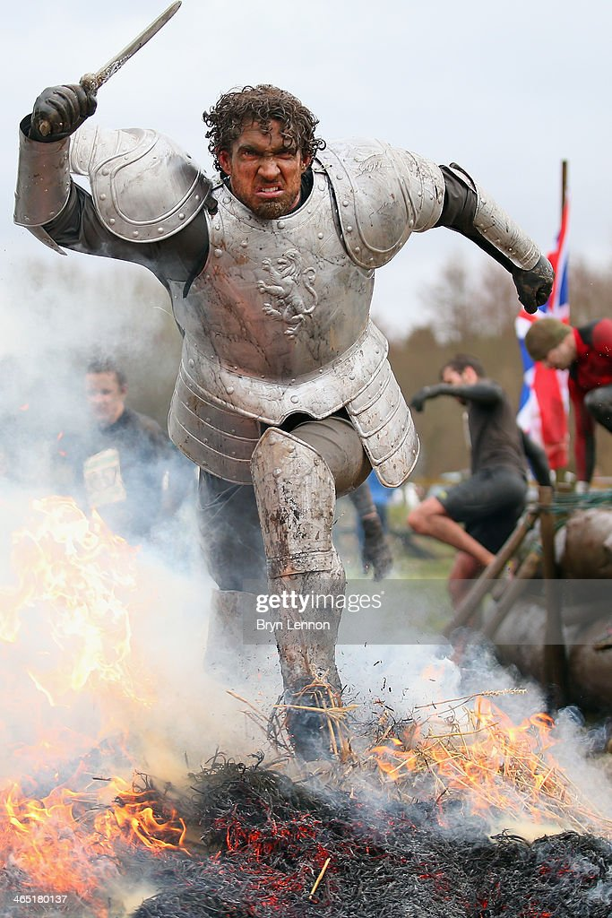 A competitor dressed as a knight runs through a fire during the Tough Guy Challenge on January 26, 2014 in Telford, England.