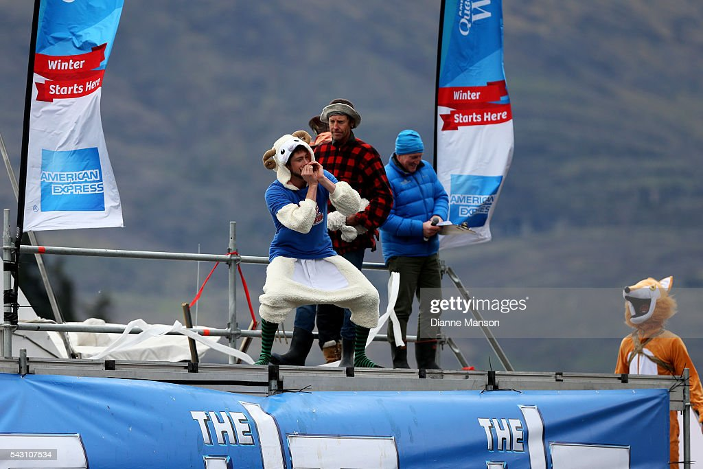 A competitor dressed as a sheep gets ready to dive off the wharf during the American Express Queenstown Winter Festival Hits 90.4 Birdman competition on June 26, 2016 in Queenstown, New Zealand.