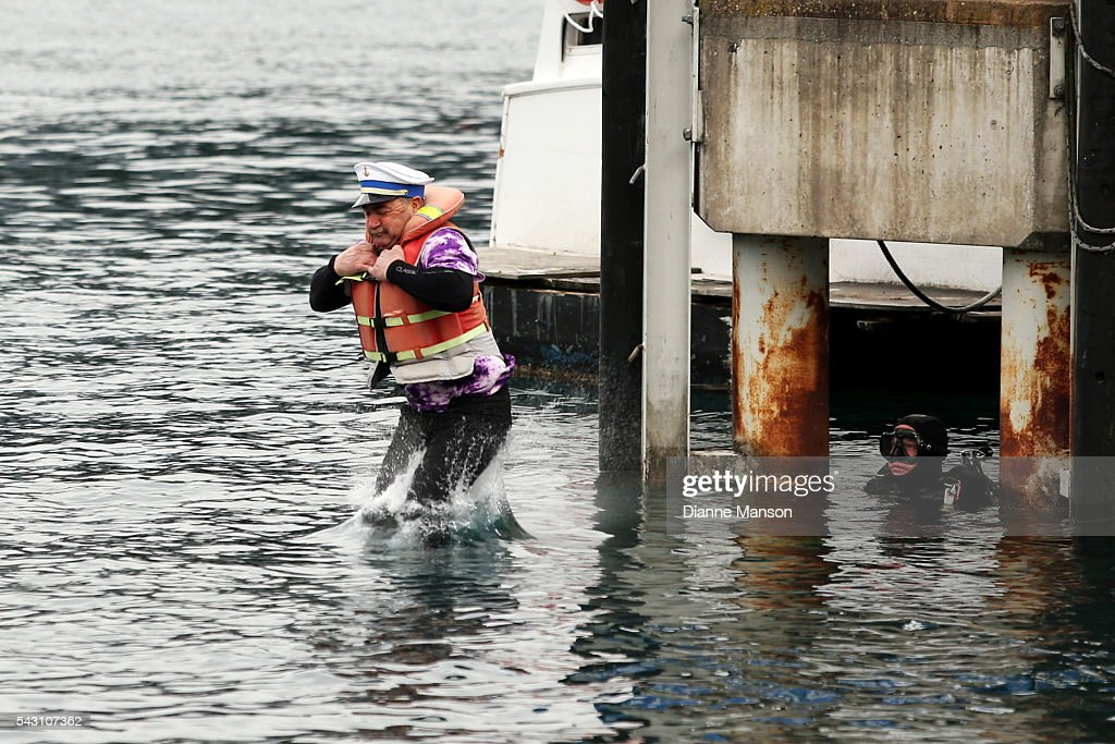 A competitor dressed as a ships captain dives off the wharf during the American Express Queenstown Winter Festival Hits 90.4 Birdman competition on June 26, 2016 in Queenstown, New Zealand.