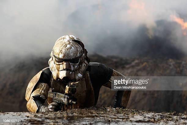 A competitor dressed as a Storm Trooper pushes themselves to the limits as they compete in the 2011 Tough Guy Challenge on January 30 2011 in Perton...
