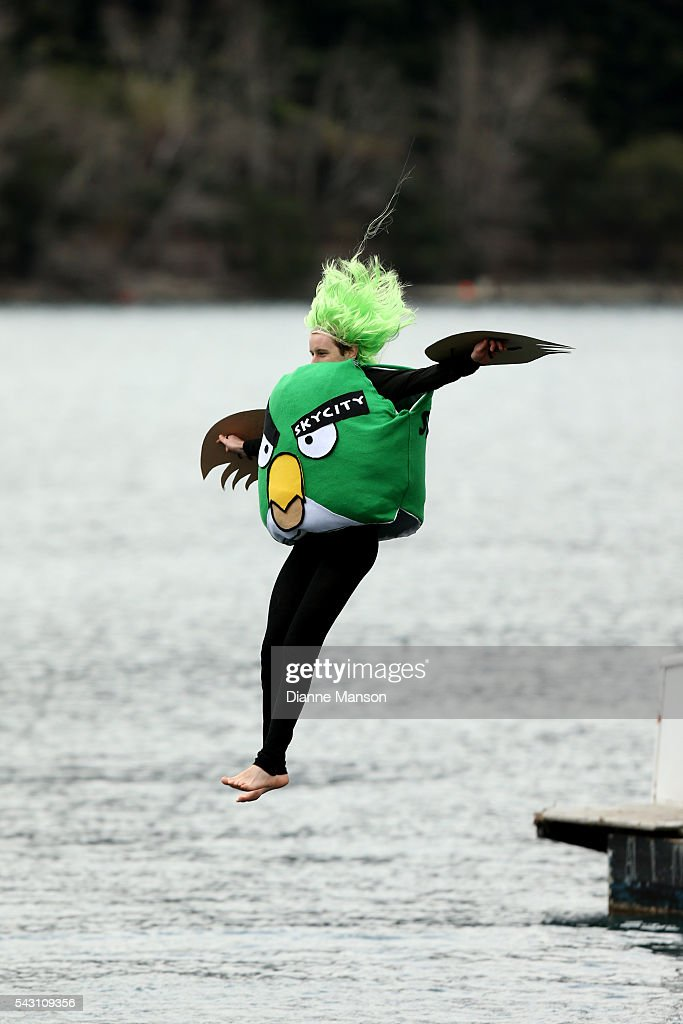 A competitor dressed as an angry bird dives off the wharf during the American Express Queenstown Winter Festival Hits 90.4 Birdman competition on June 26, 2016 in Queenstown, New Zealand.