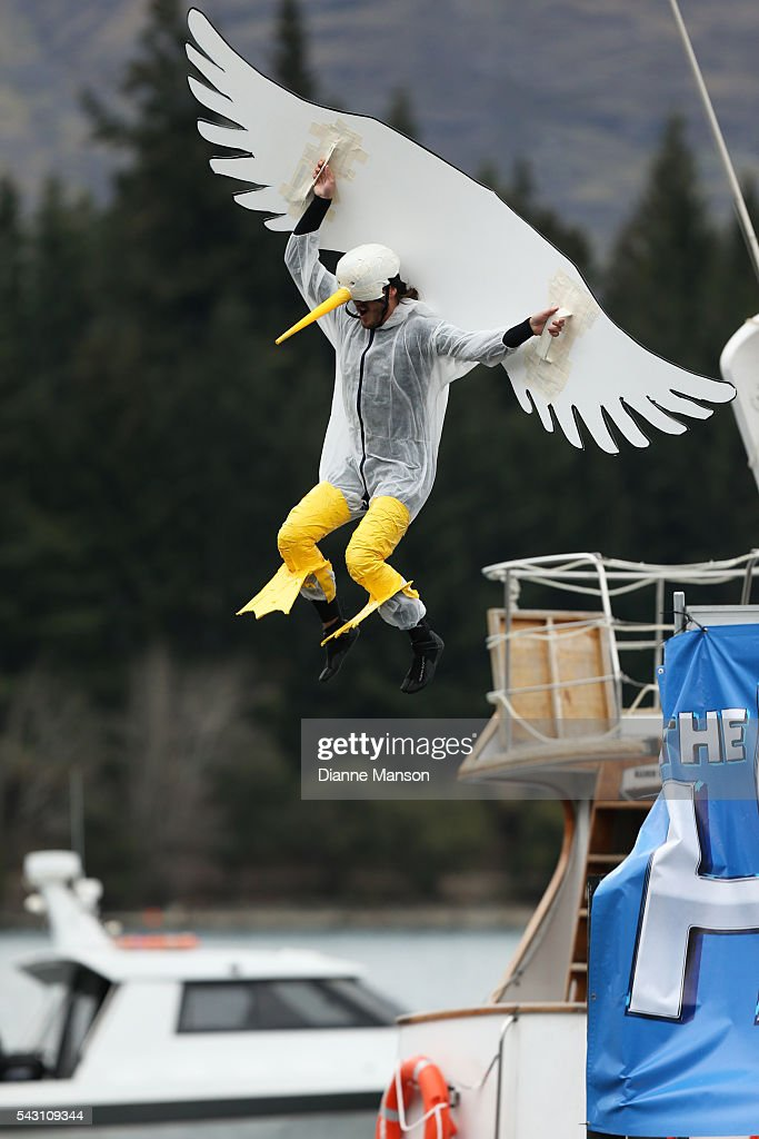 A competitor dressed as an seagull dives off the wharf during the American Express Queenstown Winter Festival Hits 90.4 Birdman competition on June 26, 2016 in Queenstown, New Zealand.