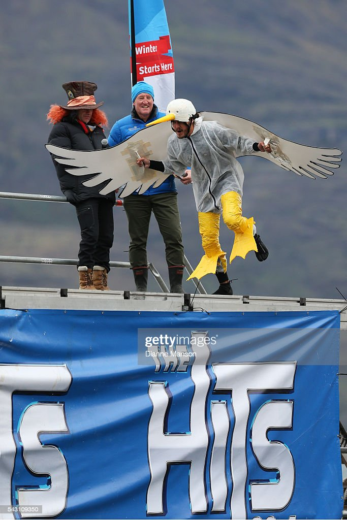 A competitor dressed as an seagull gets ready to dive off the wharf during the American Express Queenstown Winter Festival Hits 90.4 Birdman competition on June 26, 2016 in Queenstown, New Zealand.