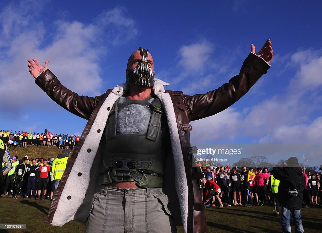 A competitor dressed as 'Bain' from the Batman films poses before the Tough Guy Challenge endurance race on January 27, 2013 in Telford, England. Every year thousands of people run the 8 mile assault course which involves freezing temperatures, fire and ice.