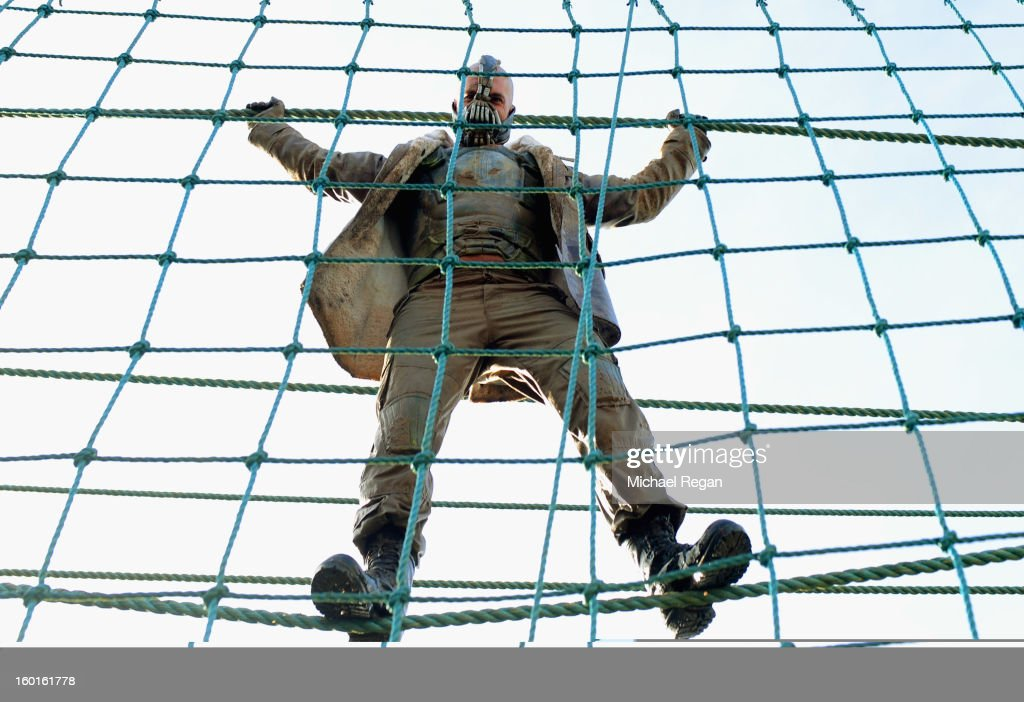 A competitor dressed as 'Bain' from the Batman films tackles the rope bridge during the Tough Guy Challenge endurance race on January 27, 2013 in Telford, England. Every year thousands of people run the 8 mile assault course which involves freezing temperatures, fire and ice.