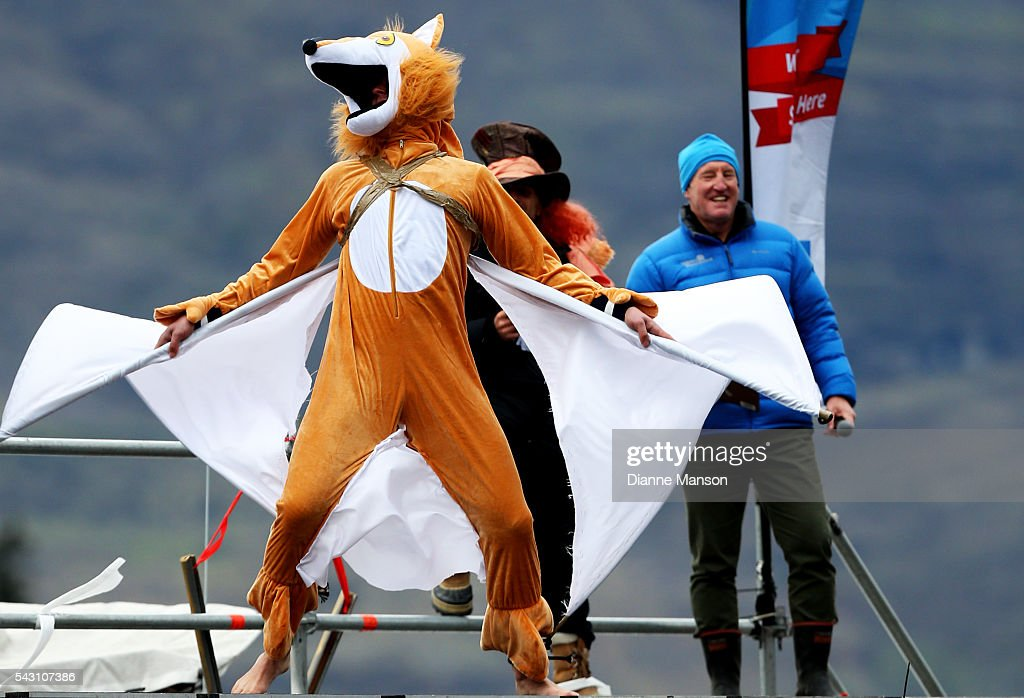 A competitor dressed as flying fox gets ready to dive off the wharf during the American Express Queenstown Winter Festival Hits 90.4 Birdman competition on June 26, 2016 in Queenstown, New Zealand.