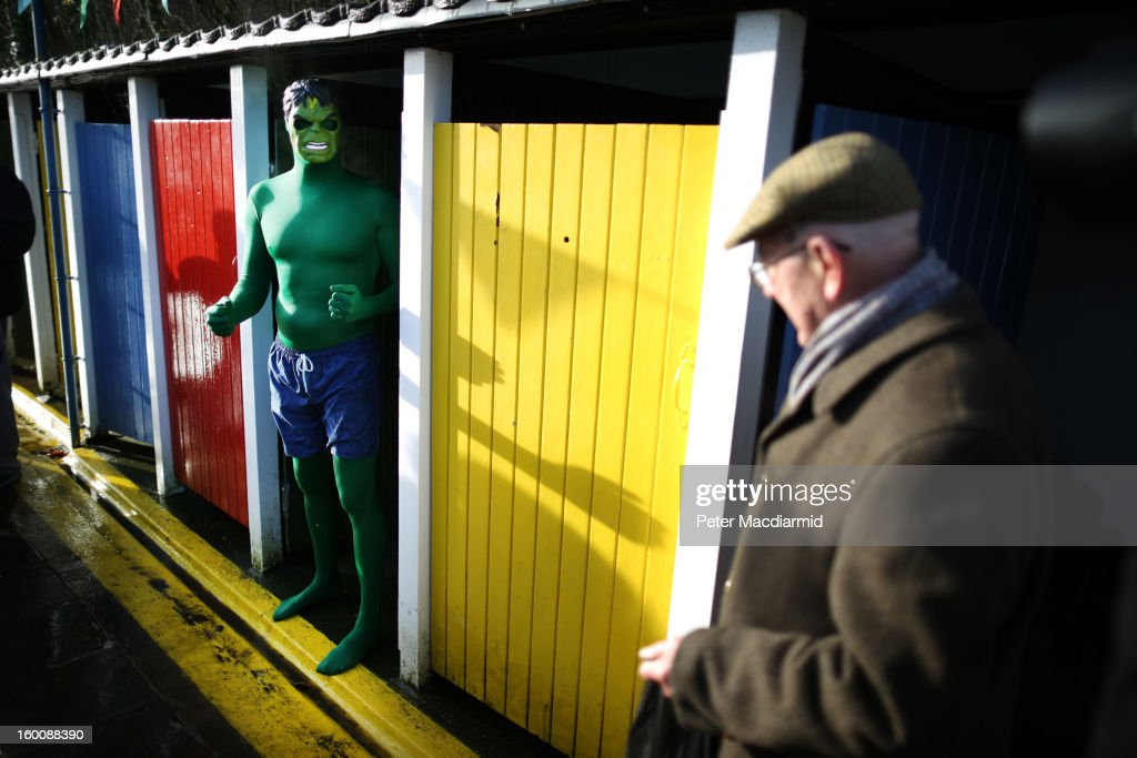 A competitor dresses as The Hulk (L) as he takes part in the UK Cold Water Swimming Championships at Tooting Bec Lido on January 26, 2013 in London, England. Open to all comers the Championships involve swimmers of all ages and abilities.