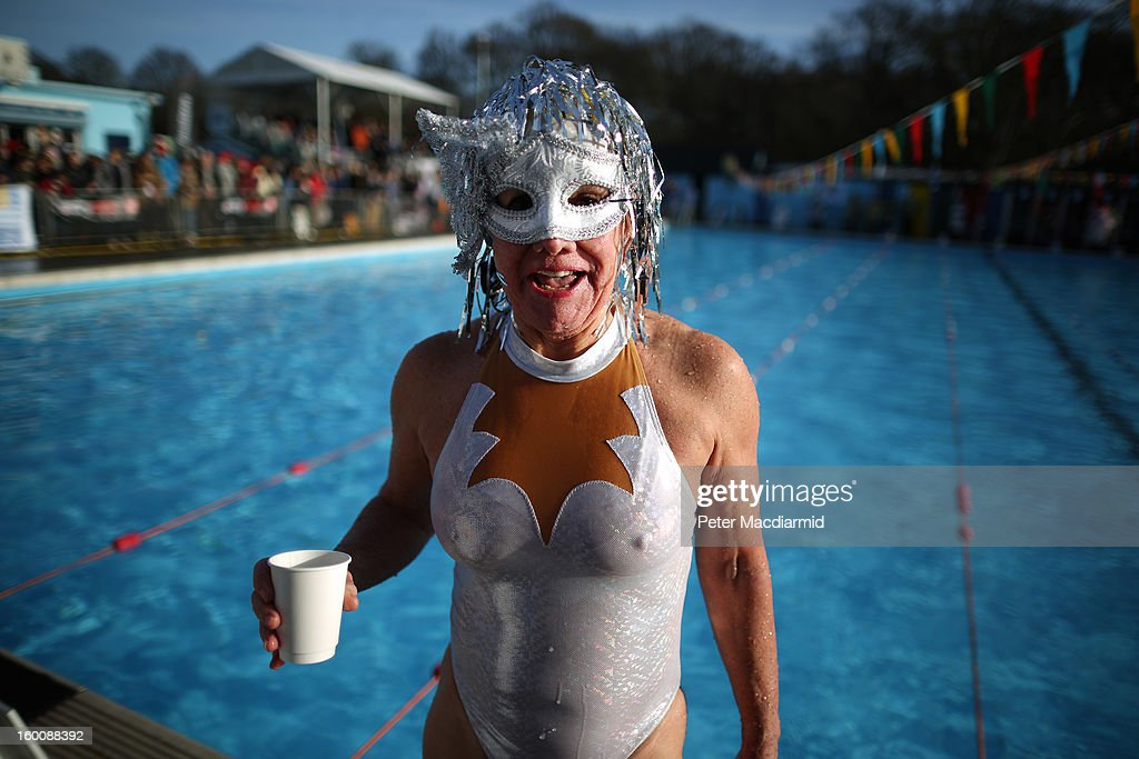 A competitor enjoys a warm drink after taking part in the UK Cold Water Swimming Championships at Tooting Bec Lido on January 26, 2013 in London, England. Open to all comers the Championships involve swimmers of all ages and abilities.