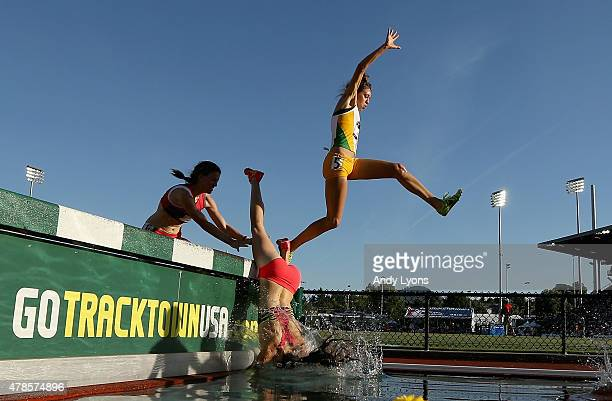 A competitor falls into the water during the Womens 3000 Meter Steeplechase during day one of the 2015 USA Outdoor Track Field Championships at...