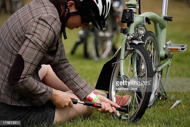 A competitor fills a tire for the Brompton World Championship folding bike race which is part of the Orbital cycling festival at Goodwood Motor...