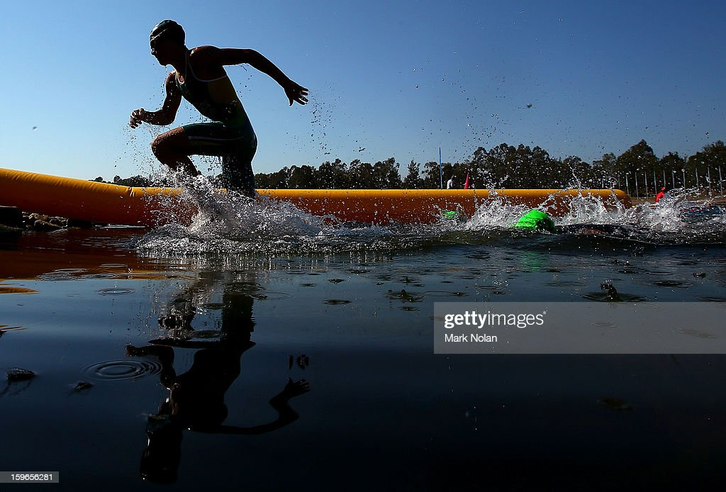 A competitor finishes the swim leg in the Mens Triathlon during day three of the 2013 Australian Youth Olympic Festival at the Sydney International Regatta Centre on January 18, 2013 in Sydney, Australia.