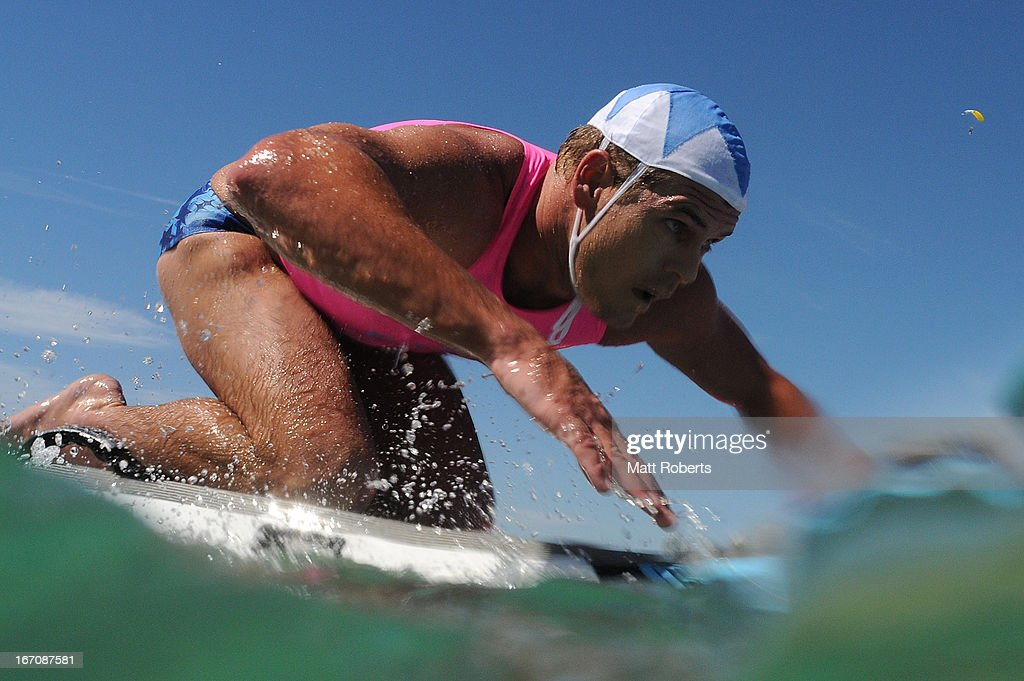 Competitor for Cudgen Headland SLSC paddles the board portion of the Open Ironman during the 2013 Australian National Surf Lifesaving Titles on April 17, 2013 on the Gold Coast, Australia.